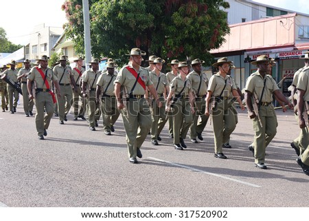 Documentary Editorial Image : Thursday Island, Torres Strait Queensland Australia â?? April 2015: ANZAC day march on Thursday Island. Active service personal from the Torres Strait and Australia    - stock photo