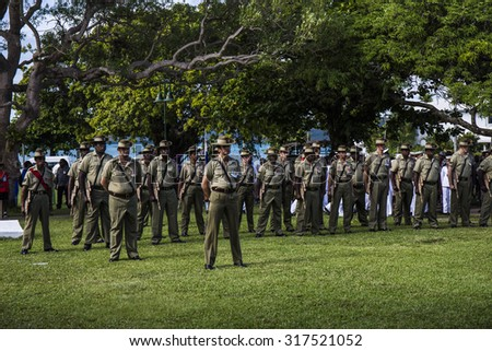 Documentary Editorial Image : Thursday Island, Torres Strait Queensland Australia â?? April 2015: ANZAC day ceremony with army, navy and police standing to attention during the minute of silence  - stock photo