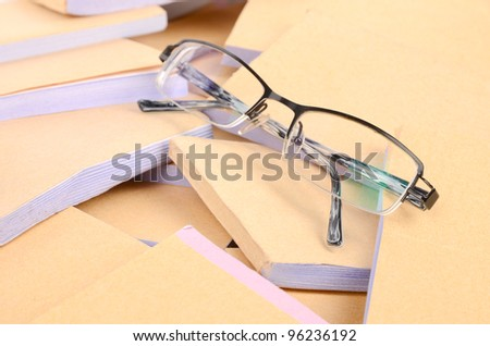 Documents and eye glasses - stock photo