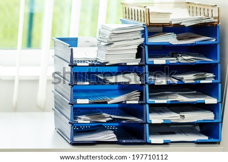 documents and projects file folders on the shelves at office - stock photo