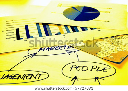 Documents with Europe and Africa map, graphs and mind map - stock photo