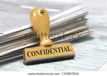 documents with rubber stamp marked with confidential - stock photo
