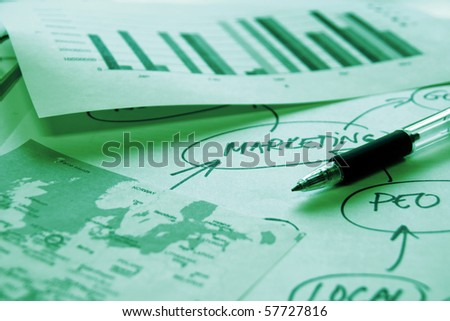 Documents with world map and graph and mind map - stock photo