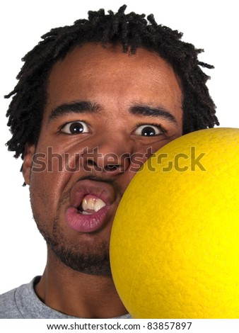 dodgeball player getting hit on the face - stock photo