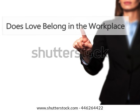 Does Love Belong in the Workplace? - Isolated female hand touching or pointing to button. Business and future technology concept. Stock Photo