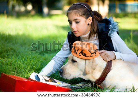 Dog and the girl on a grass in park - stock photo