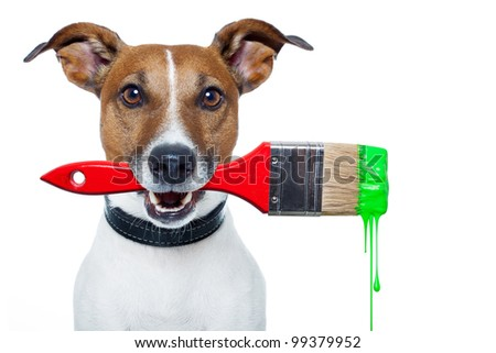 dog as a painter with a brush and green color - stock photo