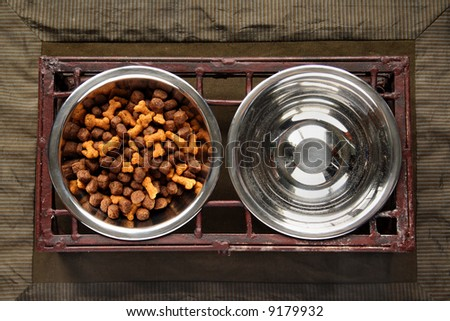 Dog Food and Water Bowls - stock photo