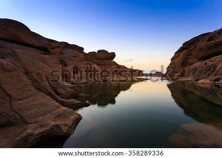 Dog head stone during sunset at Grand canyon Thailand - stock photo