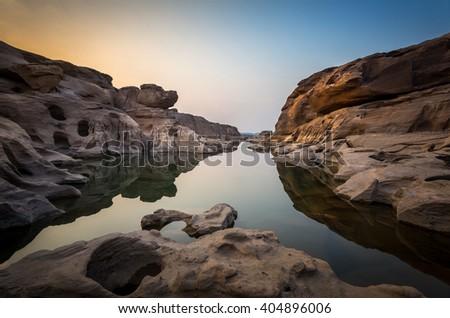 dog head stone on the cliff of Sam Pan Bok canyon in Ubonrachatani province northeast of Thailand - stock photo