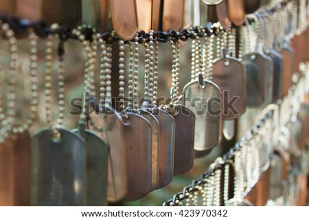 Dog Tags Honoring Fallen Soldiers - stock photo
