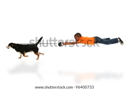 Dog Taking Happy Handsome Black Boy Child for Walk over White. - stock photo