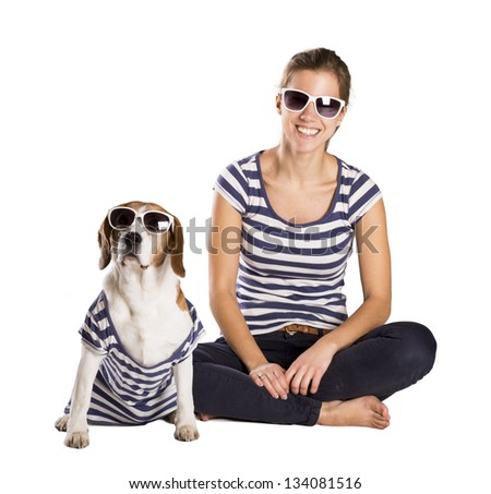 Dog with woman are posing in studio - isolated on white background - stock photo