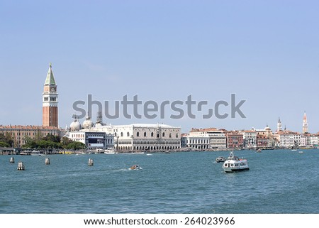 Doges palace, campanile of St. Marco, St. Marco lion statue  and water traffic in summer Venice - stock photo