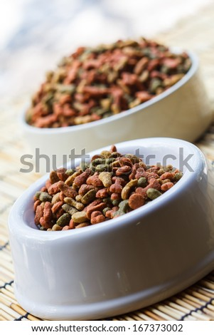 Dogs food in a white cup - stock photo