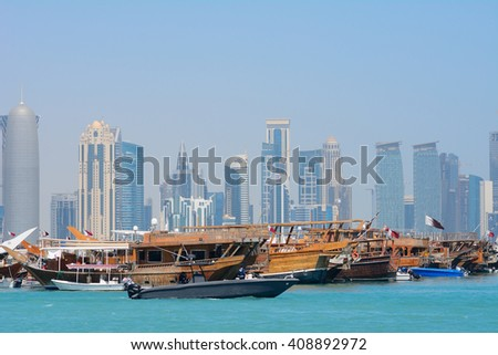DOHA - MARCH 1 : Dhows at the bay at 1 March, 2015 in Doha, Qatar. Dhows are wooden boats used in the Arabic and African countries. - stock photo