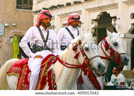DOHA - MARCH 1 : Police on horse in traditional clothes at 1 March, 2015 in Doha, Qatar. Doha has a unique police squad wearing traditional Arabic costume. - stock photo