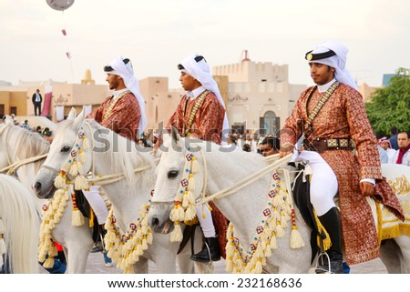DOHA/QATAR - DECEMBER 18: Qatar Emiri Knights are performing military stand on Qatar National Day on the 18th of December 2012. The event is held on December 18th of every year since 2007. - stock photo