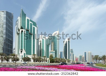 DOHA, Qatar - February 11, 2015: Towers on Doha Corniche, including the Islamic Ministry, Salam Tower, Electricity ministry and Doha Bank - stock photo