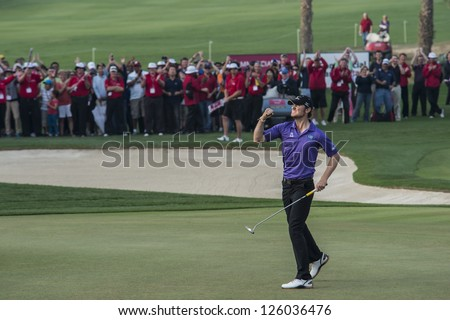 DOHA, QATAR - JANUARY 26: Chris Wood wins the US$2.5 million Commercial Bank Qatar Masters in style with an eagle putt on the 18th on January 26, 2013 in Doha Qatar. - stock photo