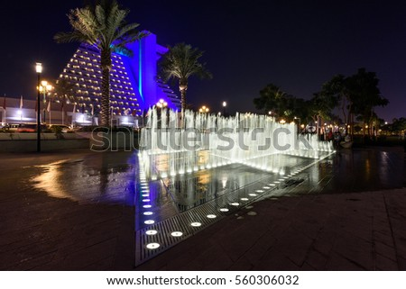DOHA, QATAR - JANUARY 20, 2017: Night view of colorful fountains at Sheraton Park in Doha, Qatar, Middle East.