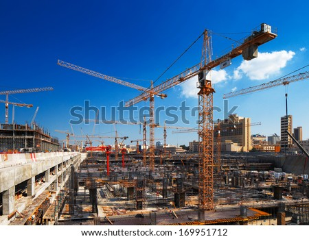 DOHA, QATAR - NOV 13: Construction continues unabated on Nov 13, 2013 in Doha, Qatar. Doha, is preparing it's infrastructure for the World Cup in 2022 - stock photo