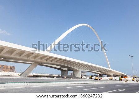 DOHA, QATAR - NOV 20: Contemporary new bridge at the highway in Lusail. November 20, 2015 in Doha, Qatar, Middle East