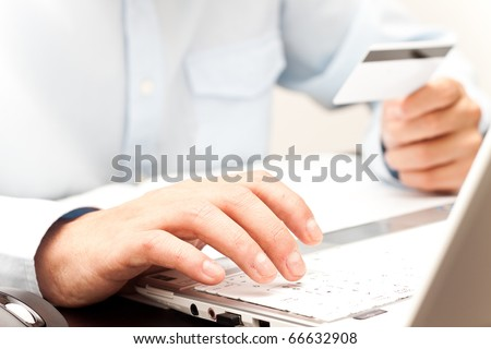 Doing shopping online using credit card - stock photo