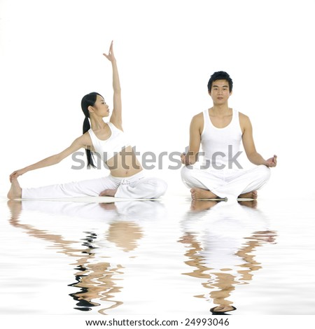 doing yoga exercises together - stock photo