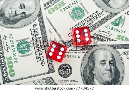 dolars and red dice on a background - stock photo