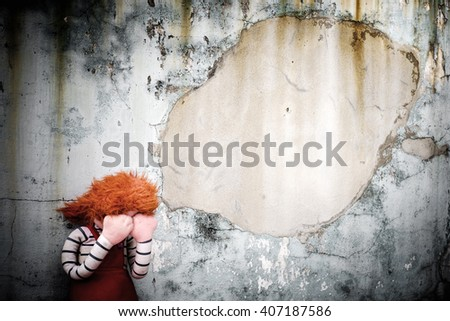 Doll Crying in dirty floor., Dark tone and copyspace. - stock photo