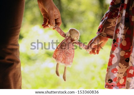 doll in hand - stock photo