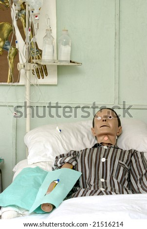 doll patient in hospital bed - stock photo