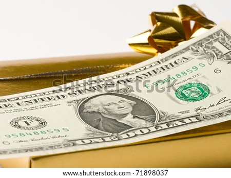 Dollar and gift isolated on white - stock photo