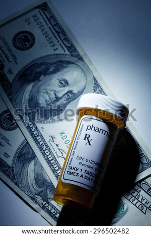 dollar and Pill Bottle, concept for Healthcare And Medicine - stock photo