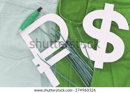Dollar and ruble characters  in your pocket jeans with greenish-blue tint shade