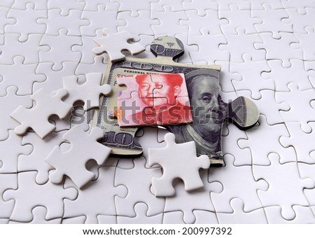 Dollar and Yuan on Puzzle - stock photo