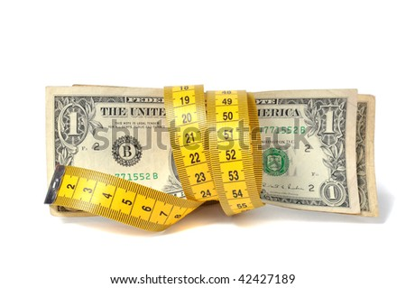 Dollar banknote and measure tape - stock photo