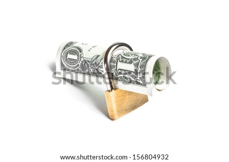 dollar banknote rolled with lock security. Money for safety and investment. - stock photo