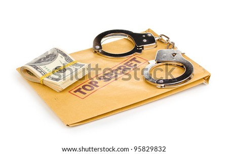 Dollar banknotes and handcuffs on top secret envelope isolated on white
