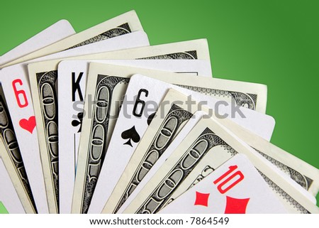Dollar banknotes and playing cards