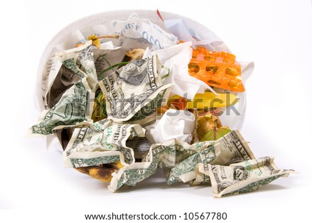 Dollar banknotes in rubbish bin - stock photo