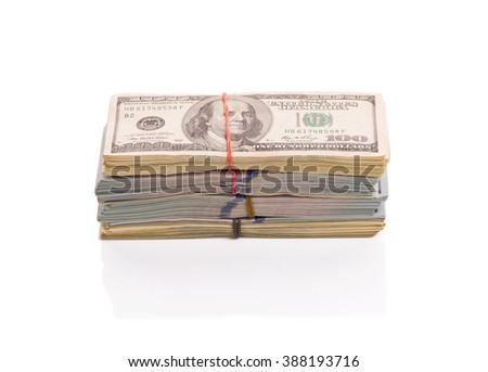 Dollar bills in stacks isolated on white background - stock photo