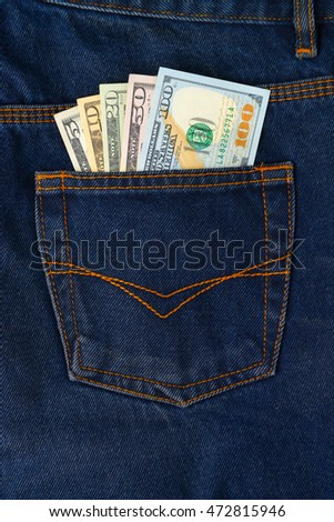 Dollar Bills in the pocket of jeans