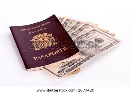 Dollar bills in the Spanish passport for travel