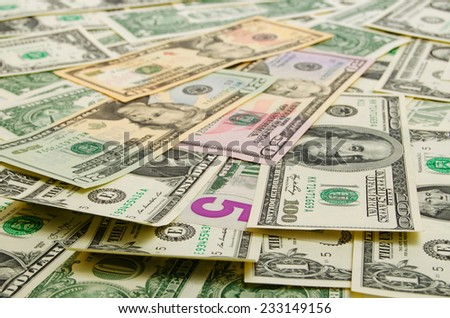 Dollar bills of various denominations in the plane. - stock photo