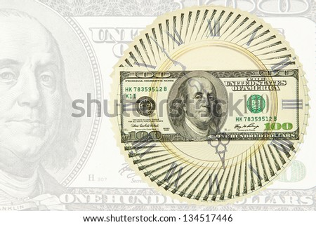 Dollar bills outlined circle on a dollar background - stock photo