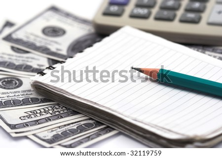 Dollar bills,pen and notebook close up - stock photo