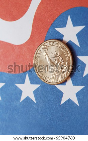 Dollar coin at Stars and Stripes - stock photo