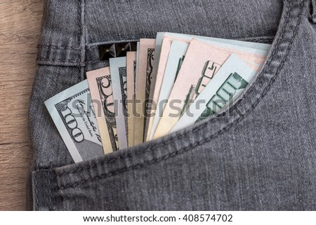 Dollar currency in jeans pocket ready for shopping